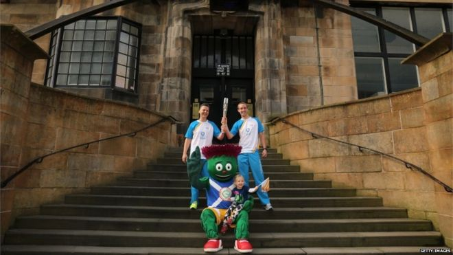William Mitchell and Michael Aldridge, with Clyde the Glasgow 2014 mascot, at Glasgow School of Art