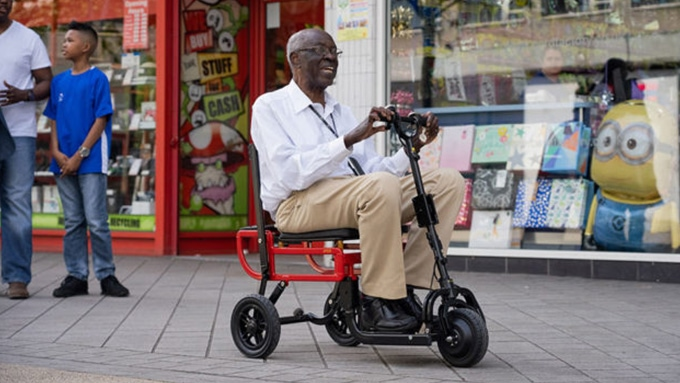 Man riding mobility scooter